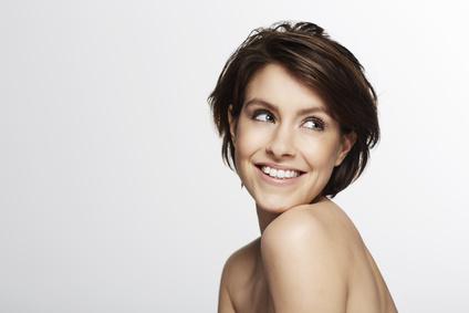 Portrait of beautiful woman looking over shoulder